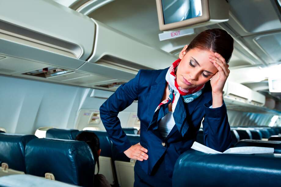 Sick passengers and flight attendants both pose a risk to air travelers during flu season. Here are some ways to reduce your chance of exposure to infection. Photo: Izusek/Getty Images / Izabela Habur