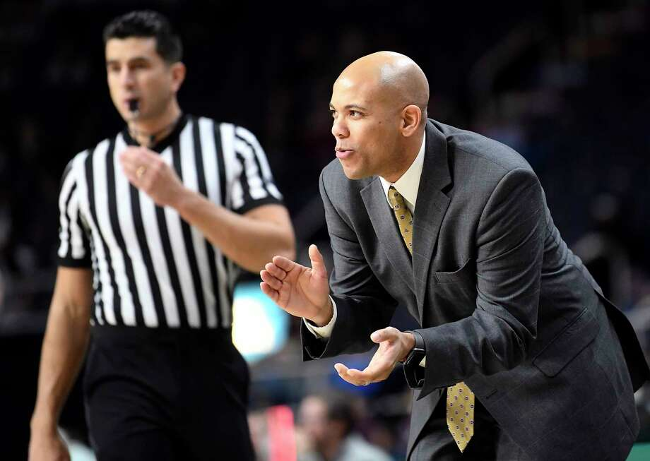 825541529e75 Siena head coach Jamion Christian instructs his players against Colgate  during an NCAA college basketball game