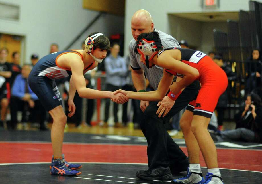 Wrestling action between Fairfield Warde and Danbury in Fairfield, Conn. on Wednesday Dec. 20, 2017. Photo: Christian Abraham / Hearst Connecticut Media / Connecticut Post