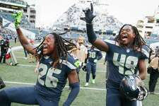 Seahawks corner back Shaquill Griffin and linebacker Shaquem Griffin celebrate their win over Dallas, Sunday, Sept. 23, 2018.