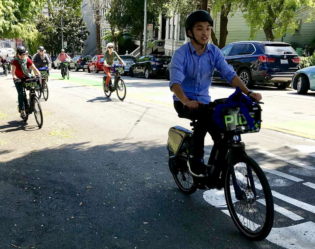 Bicyclists test new Ford GoBikes with electric pedal assist up Page Street in Hayes Valley on Tuesday