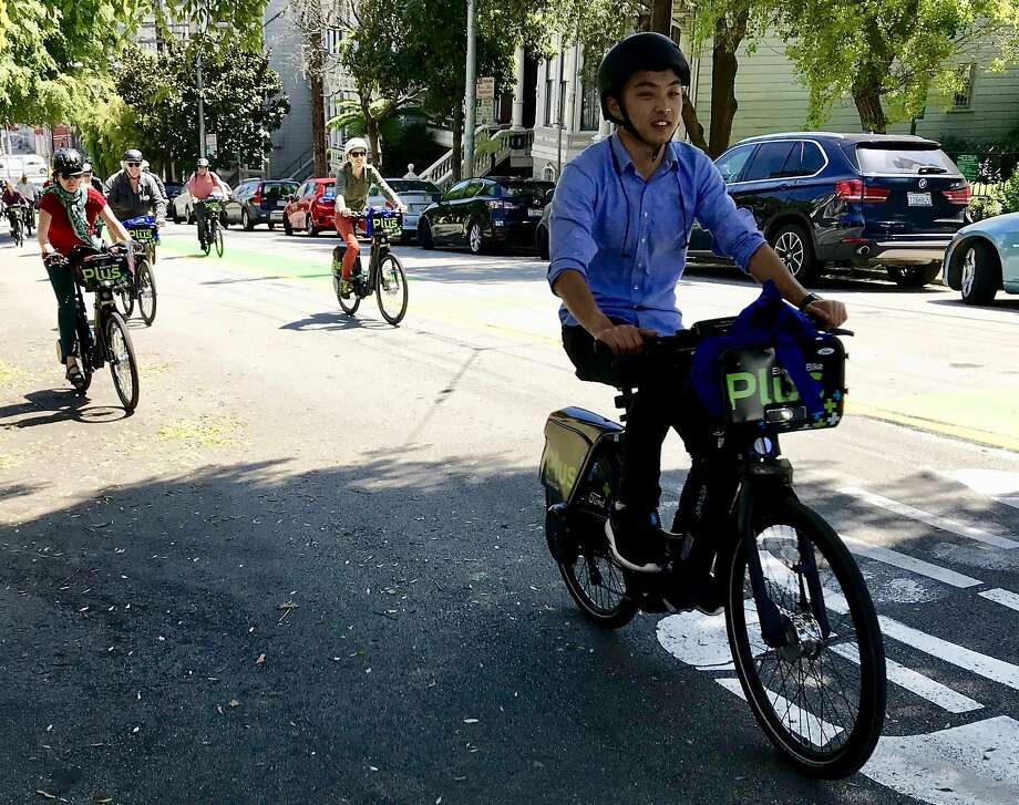 Bicyclists test new Ford GoBikes with electric pedal assist up Page Street in Hayes Valley on Tuesday Photo: Michael Cabanatuan / The Chronicle