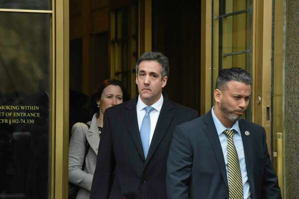 Michael Cohen, center, the former lawyer for President Donald Trump, exits federal court after his sentencing in Manhattan, Dec. 12, 2018. Cohen was sentenced to three years in prison on Wednesday morning for his role in a hush-money scandal that could threaten Trump?'s presidency by implicating him in a scheme to buy the silence of two women who said they had affairs with him. (Stephanie Keith/The New York Times)