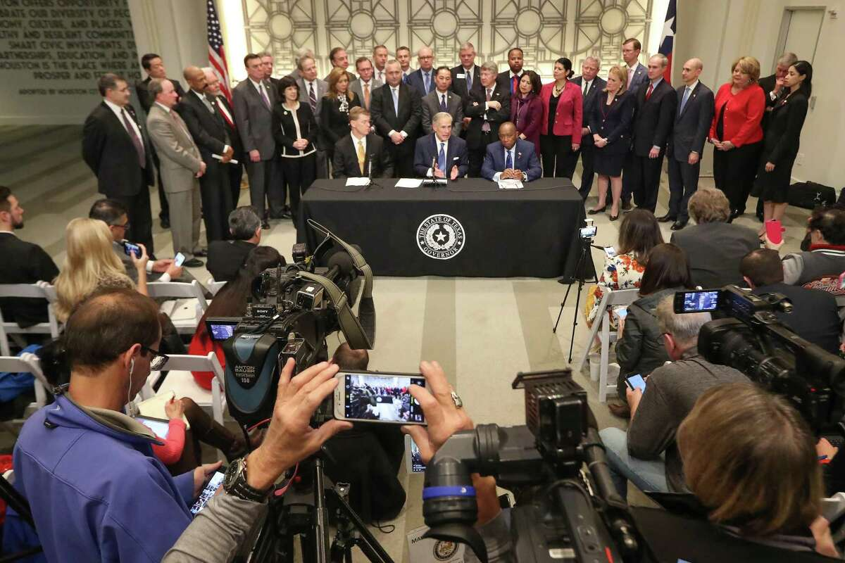 Gov. Greg Abbott (c), Mayor Sylvester Turner (r) and Nim Kidd, Chief of Texas Emergency Management announced funding for flood relief and prevention Tuesday, Feb. 13, 2018, in Houston. ( Steve Gonzales / Houston Chronicle )