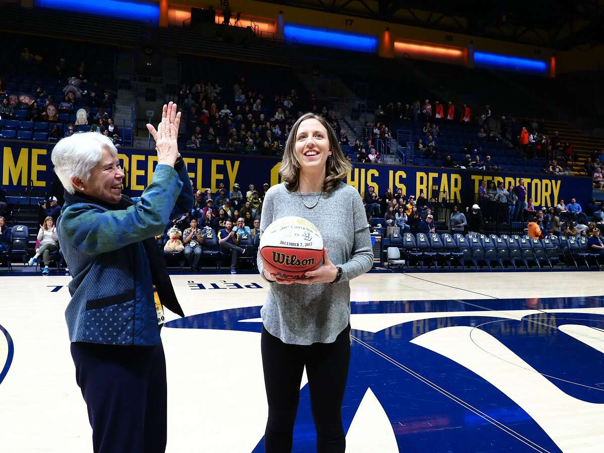 Cal women�s basketball Head Coach Lindsay Gottlieb was recognized for her 200th collegiate win (which she earned on Dec. 7, 2017 ) before a women�s basketball game at Hass Pavillion in Berkeley on Friday, January 12, 2018. UC Berkeley Chancellor Carol Christ presented Caoch Gottlieb will a commemorative ball insribed with the date of her achievemnt.