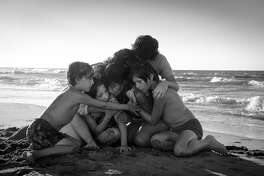 One of the many moving sequences with Cleo and the family she cares for in ?Roma? takes place on a beach. (Carlos Somonte/ Netflix)