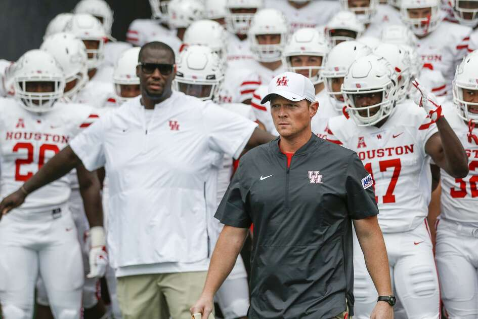 Houston head coach Major Applewhite leads his team out of the tunnel for an NCAA football game against Rice at Rice Stadium on Saturday, Sept. 1, 2018, in Houston.