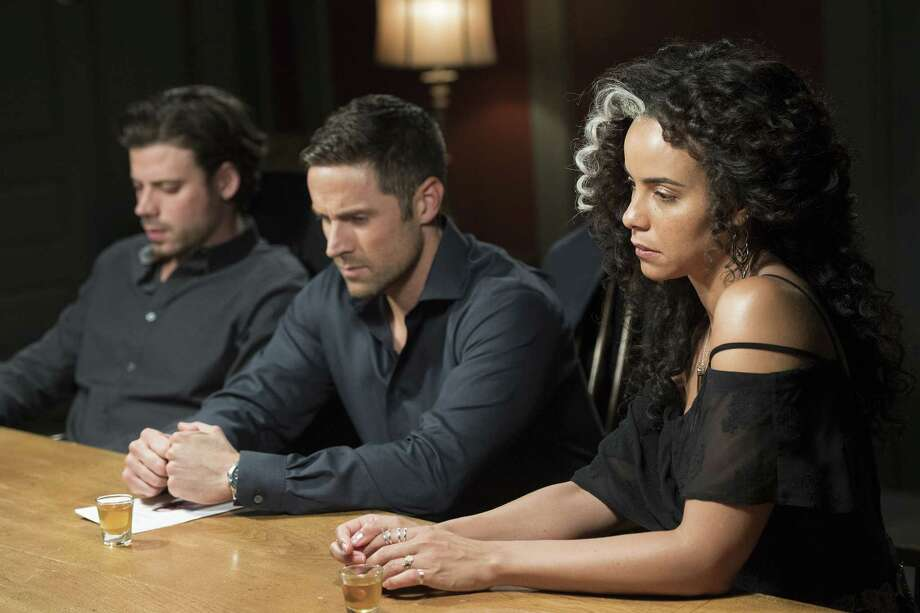 "MIDNIGHT, TEXAS -- ""Resting Witch Face"" Episode 207 --  Pictured: (l-r)  Francois Arnaud as Manfred, Dylan Bruce as Bobo, Parisa Fitz Henley as Fiji -- (Photo by: Lewis Jacobs/NBC) Photo: NBC / 2018 NBCUniversal Media, LLC"