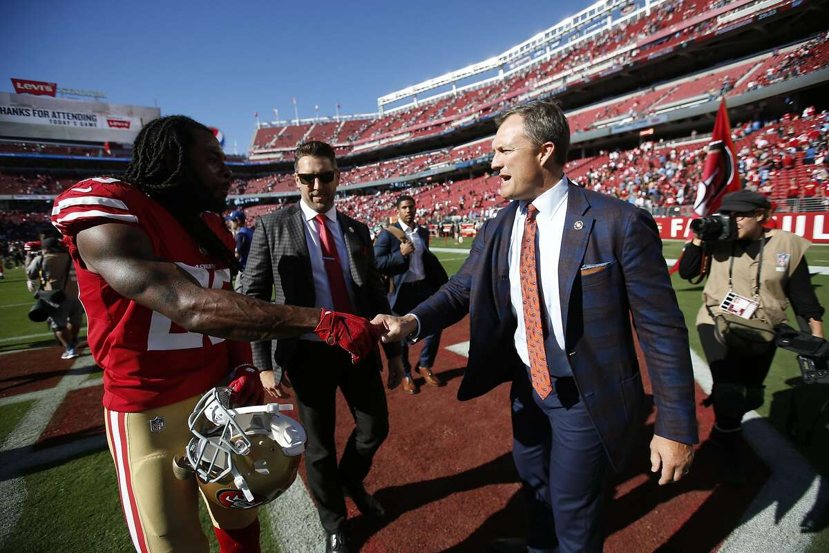 SANTA CLARA, CA - SEPTEMBER 16: Richard Sherman #25 and General Manager John Lynch of the San Francisco 49ers talk on the field following the game against the Detroit Lions at Levi Stadium on September 16, 2018 in Santa Clara, California. The 49ers defeat