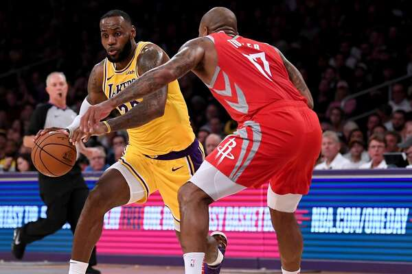 LOS ANGELES, CA - OCTOBER 20: LeBron James #23 of the Los Angeles Lakers drives to the basket on PJ Tucker #17 of the Houston Rockets at Staples Center on October 20, 2018 in Los Angeles, California. (Photo by Harry How/Getty Images)