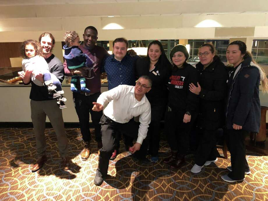 Workers at the Sheraton Hotel in Stamford voted on Thursday to unionize. Workers posed for a photo just outside of the room where votes were counted. The final tally was 69 votes in favor and 32 opposed. Photo: Ignacio Laguarda / Hearst Connecticut Media / Stamford Advocate