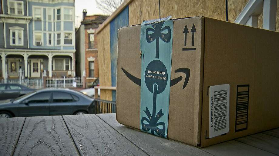 This image taken from video shows an Amazon package containing a GPS tracker on the porch of a Jersey City, N.J. residence after its delivery Tuesday, Dec. 11, 2018. Click through the gallery to see high risk SF blocks for car break-ins. Photo: Robert Bumsted / Associated Press 2018
