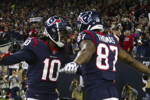 Houston Texans wide receiver Demaryius Thomas (87) celebrates his second touchdown of the night with wide receiver DeAndre Hopkins (10) during the fourth quarter of an NFL football game at NRG Stadium on Monday, Nov. 26, 2018, in Houston.