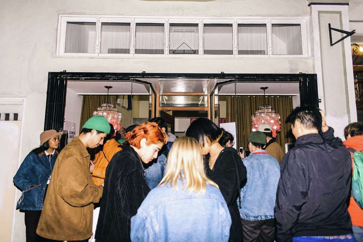 People gather at O. P. MART,Toro Y Moi aka Chaz Bear's installation at Family Affair, an art gallery in San Francisco, Calif.