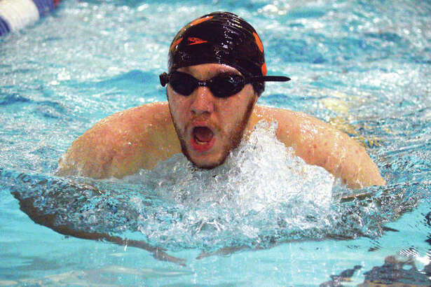 Edwardsville senior Evan Williams competes in the 100-yard breaststroke during Thursday's dual meet against O'Fallon at Chuck Fruit Aquatic Center.