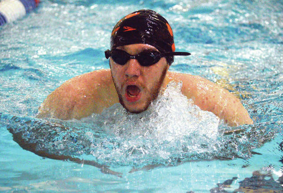 Edwardsville senior Evan Williams competes in the 100-yard breaststroke during Thursday's dual meet against O'Fallon at Chuck Fruit Aquatic Center. Photo: Scott Marion/Intelligencer