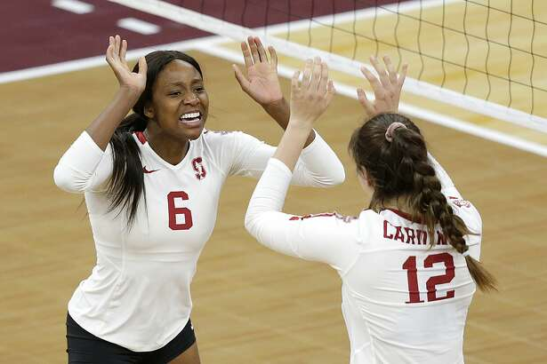 Stanford's Tami Alade and Andriana Fitzmorris celebrate a point against BYU in the first set of a semifinal match of the NCAA Div I Women's Volleyball Championships Thursday, Dec. 13, 2018, in Minneapolis. (AP Photo/Andy Clayton-King)
