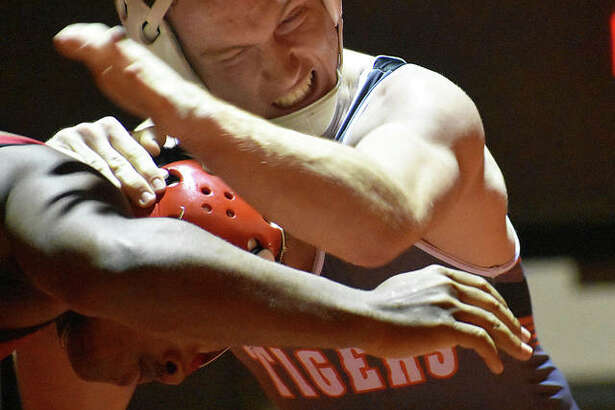 Edwardsville's Drew Gvillo wrestles Granite City's Andre Mitchell during the 160-pound match on Thursday inside Jon Davis Wrestling Center. EHS wrestling vs. Granite City