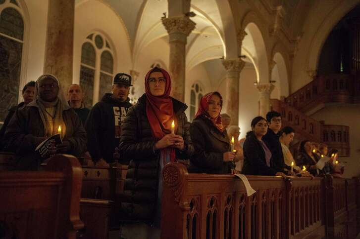 San Antonio area residents and University of the Incarnate Word attend Thursday's vigil marking the sixth anniversary of the Sandy Hook Elementary shooting and calling for an end to gun violence.