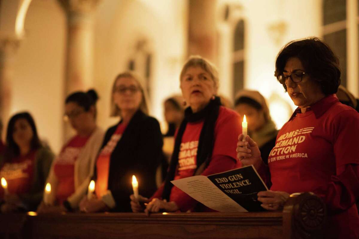 Members of the San Antonio Moms Demand Action for Gun Sense in America attend the University of the Incarnate Word's vigil held Thursday to mark the sixth anniversary of the Sandy Hook Elementary shooting.