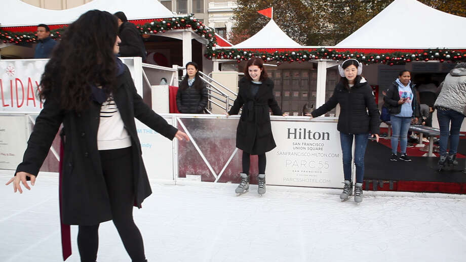 SFGATE producer Filipa Ioannou, back center, hesitates to let go of the wall during an ice skating lesson at San Francisco's Union Square ice rink on Sunday, Dec. 9, 2018, just in time for the holidays. Photo: Katie Wood/SFGATE