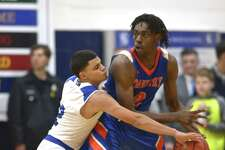 Tech's Marcos Gonzalez (2) knocks away the ball from Danbury's Denali Burton (2) as Abbott Tech played Danbury High School in the opening game of The News Times Tip Off Classic basketball tournament, Thursday night, December 13, 2018, at Immaculate High School, in Danbury, Conn.