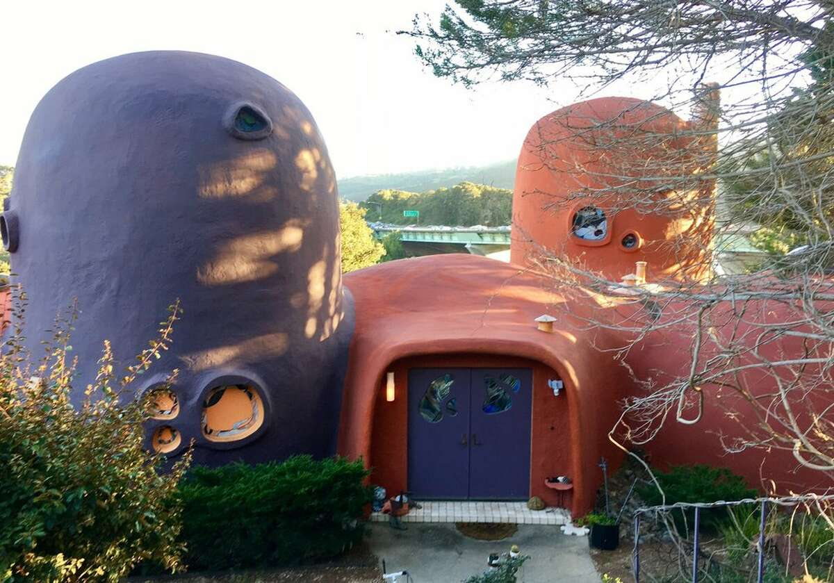 """Constructed by architect William Nicholson in 1976, the Flinstone house built to experiment with new building materials and techniques. The home is a favorite of I-280 rubberneckers and fans of the 1960s animated television series """"The Flinstones."""" The home was purchased in 2017 by a private buyer, so it's best viewed while cruising down I-280."""