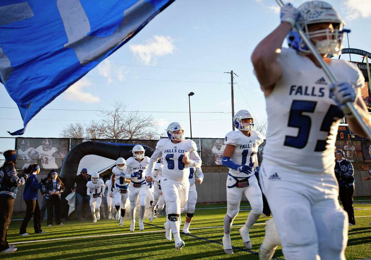 Falls City players run onto the field for their game against Mart at their 2A UIL football state semifinals game at the Georgetown ISD Athletic Complex on December 13, 2018 in Georgetown, Texas. (Thao Nguyen/Special Contributor)
