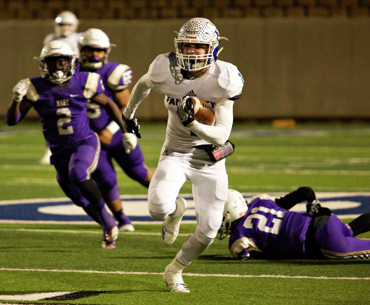 Falls City's Brady Lyssy (7) breaks a big run during a Class 2A playoff game against Mart at the Georgetown ISD Athletic Complex on Dec. 13, 2018.