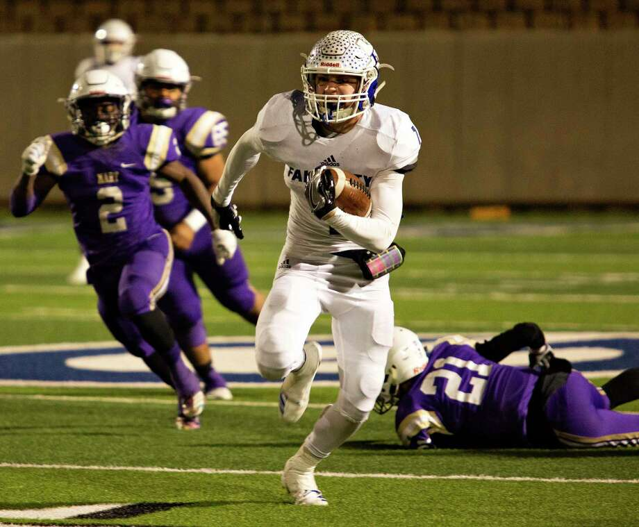 Falls City's Brady Lyssy (7) breaks a big run during a Class 2A playoff game against Mart at the Georgetown ISD Athletic Complex on Dec. 13, 2018. Photo: Thao Nguyen /Contributor / Thao Nguyen
