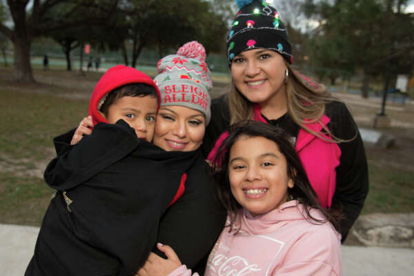 San Antonio's West got into the Christmas spirit with a tree lighting ceremony at Woodlawn Lake Park's Island House Thursday night, Dec. 13, 2018. The event included holiday caroling and some holiday sweet treats.