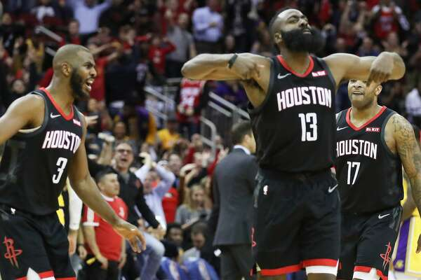 Houston Rockets guard James Harden (13) reacts to a score over Los Angeles Lakers forward LeBron James (23) that made the crowd go crazy during the second half of an NBA basketball game at Toyota Center on Thursday, Dec. 13, 2018, in Houston.