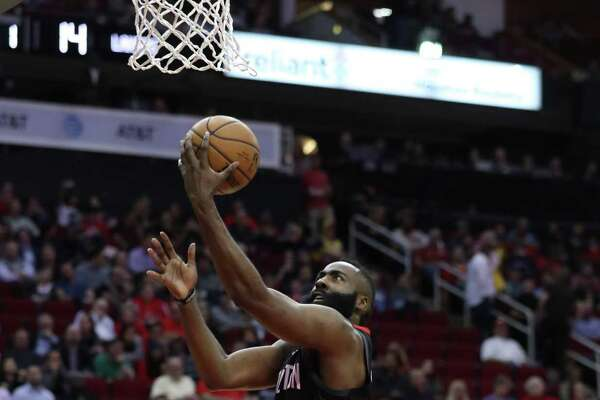 Rockets guard James Harden goes in for a layup on his way to 50 points against the Lakers at Toyota Center.