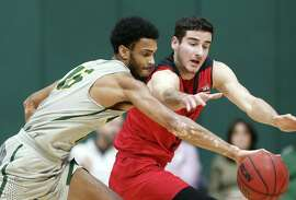 San Francisco's Nate Renfro steals a pass intended for Eastern Washington's Luka Vulikic in 1st half during men's college basketball game in San Francisco, Calif. on Thursday, December 13, 2018.