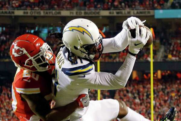 Los Angeles Chargers wide receiver Mike Williams (81) makes a touchdown catch against Kansas City Chiefs cornerback Steven Nelson (20) during the first half of an NFL football game in Kansas City, Mo., Thursday, Dec. 13, 2018. (AP Photo/Charlie Riedel)