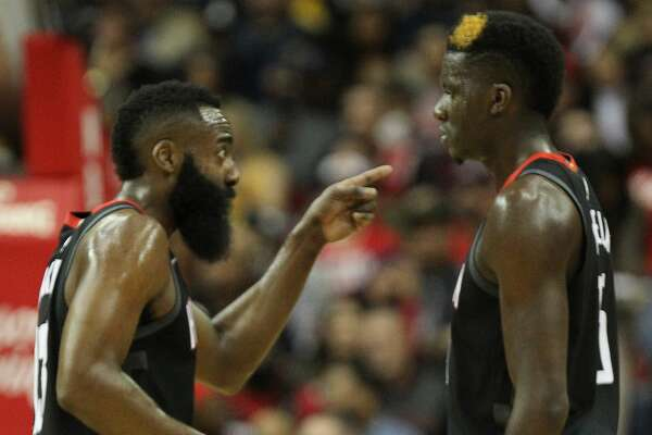 Houston Rockets guard James Harden (13) makes a point to team mate Houston Rockets center Clint Capela (15) during the second half of an NBA basketball game at Toyota Center on Thursday, Dec. 13, 2018, in Houston.