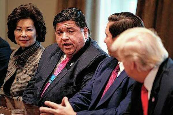 Illinois Governor-elect J.B. Pritzker talks Thursday with President Donald Trump during a meeting with newly elected governors in the Cabinet Room of the White House.