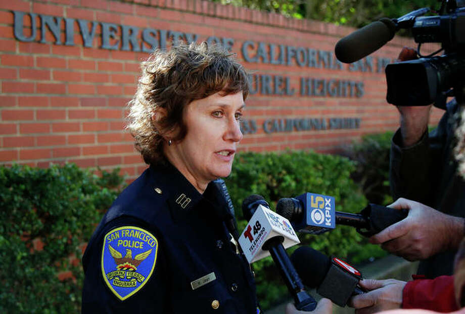 San Francisco Police Capt. Michelle Jean speaks to reporters Thursday. Bomb threats sent to hundreds of schools, universities and other locations across the U.S. appear to be a hoax, authorities say. Photo: Jeff Chiu | AP