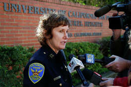 San Francisco Police Capt. Michelle Jean speaks to reporters Thursday. Bomb threats sent to hundreds of schools, universities and other locations across the U.S. appear to be a hoax, authorities say.