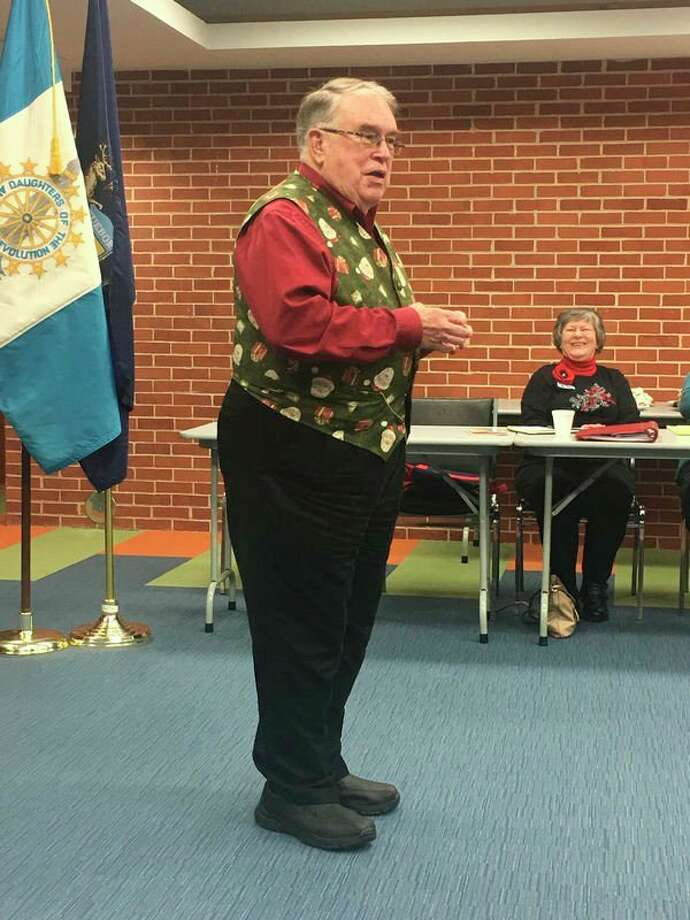 Fred Honerkamp talks about the Midland Santa House and School at the John Alden Chapter, DAR. (Photo provided)