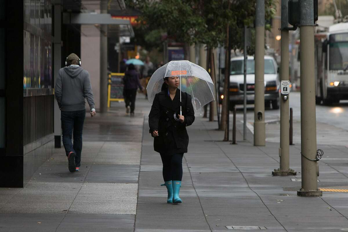 Light to moderate rain caused pedestrians in San Francisco to seek cover on Tuesday morning November 24, 2015.