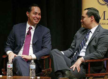 Former San Antonio Mayor and Secretary of Housing and Urban Development, Julian Castro, (left) and twin brother U.S. Rep. Joaquin Castro, D-San Antonio, joke during the Making the Grade: A Conversation with Julian, Joaquin, and Rosie Castro event held Monday Feb. 19, 2018 at the Prothro Theater in the Harry Ransom Center on the University of Texas at Austin campus in Austin, Tx.