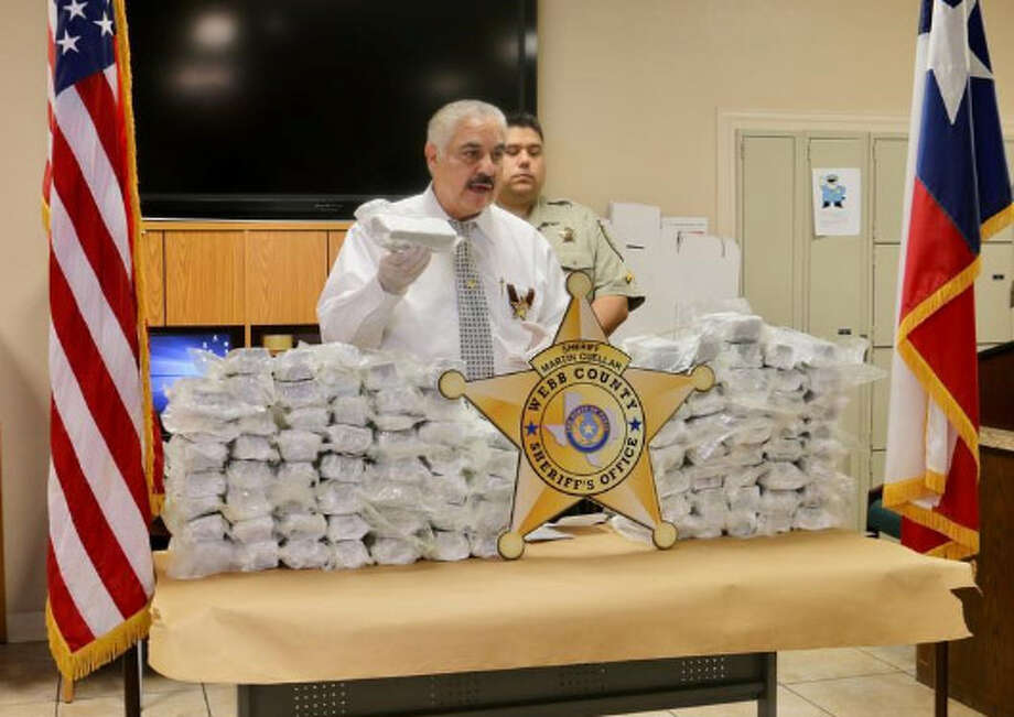 Sheriff Martin Cuellar talks about a narcotics operation that yielded several arrests and about 115 pounds of marijuana. Photo: Courtesy