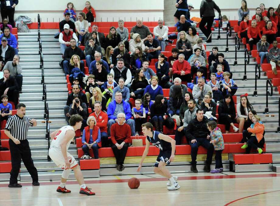 A boys high school basketball game at Greenwich High School on Feb. 9, 2018. All basketball games will be relocated for the next several weeks due to damage from a leak. Photo: File / Hearst Connecticut Media / Greenwich Time