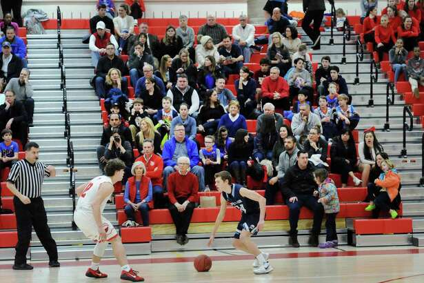 A boys high school basketball game at Greenwich High School on Feb. 9, 2018. All basketball games will be relocated for the next several weeks due to damage from a leak.