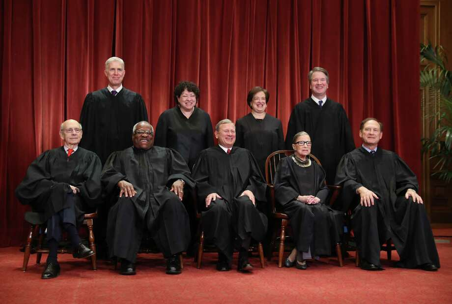 Justices of the U.S. Supreme Court pose during a formal group photograph in the East Conference Room of the Supreme Court in Washington, D.C., U.S., on Friday, Nov, 30, 2018. Seated from left: Associate Justice Stephen Breyer, Associate Justice Clarence Thomas, Chief Justice John Roberts, Associate Justice Ruth Bader Ginsburg and Associate Justice Samuel Alito Jr. Standing from left: Associate Justice Neil Gorsuch, Associate Justice Sonia Sotomayor, Associate Justice Elena Kagan and Associate Justice Brett Kavanaugh. Photo: Bloomberg Photo By Andrew Harrer. / © 2018 Bloomberg Finance LP