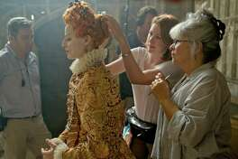 "Margot Robbie, left, is seen with hair and makeup designer Jenny Shircore, right, on the set of ""Mary Queen of Scots."""