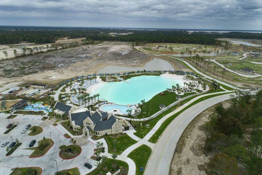 The new lagoon in the Balmoral development is comprised of several separate pools and white sand beaches in Humble. Some residents of Balmoral are banding together, worried that the developer is now offering memberships to people outside of the community and selling the space as a wedding venue.