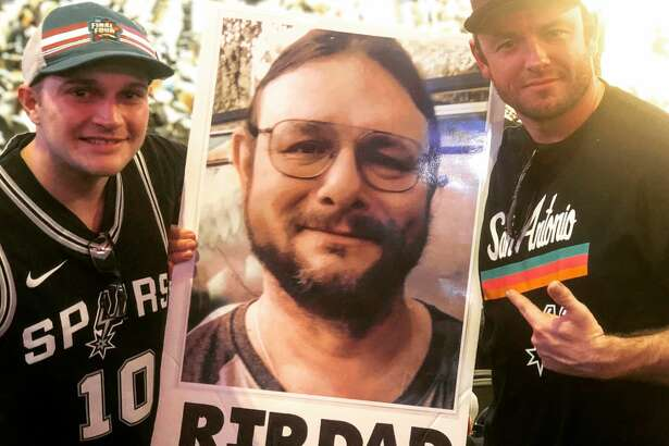 Logan Lott (right) with his new friend, John Huff (left), who helped him honor his late father, Randy Lott (middle) at the Spurs vs. Los Angeles Clippers game on Dec. 13, 2018.