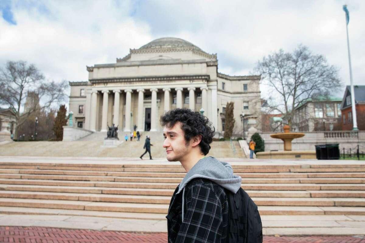 Isaiah Guzman walks across campus back to his dorm on Nov. 27, 2018 in Manhattan. Guzman has a scholarship through the QuestBridge program, which partnered him with Columbia University.